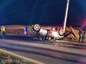 This vehicle struck a utility pole and overturned on Route 82.