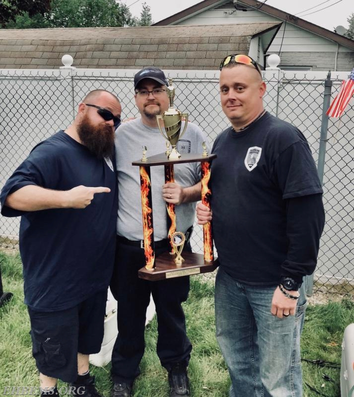 EMT J. McCully, Chief Carmen & Captain Huntsinger with the first place trophy.