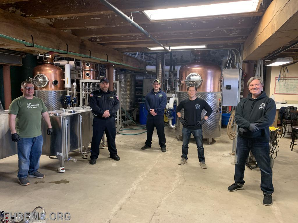 Lt. G. Morgan & Captain C. Dunlap with staff members at Brandywine Branch Distillery practicing social distancing while posing for a quick picture.
